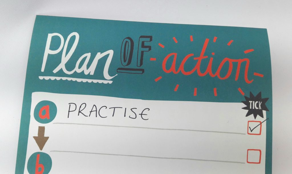 Image of a notepad with the words 'Plan of Action' and 'Practise' written on it