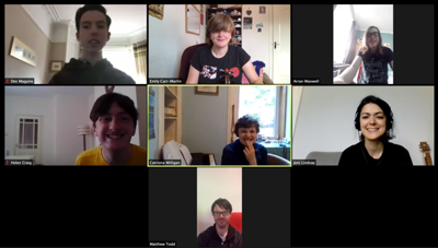 A screenshot of a Zoom call with 7 smiling faces